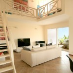Terrasse A La Mer - Jan Thiel Curacao - Woonkamer en Vide Waterfront Penthouse Appartement